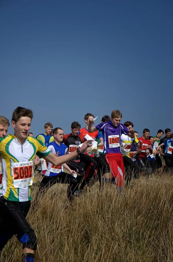 Mass start of orienteers at adventure race in great outdoors