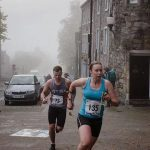 Orienteers racing urban event as an adventurous sport in Scotland