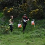 2 young orienteers enjoying group activity Scotland