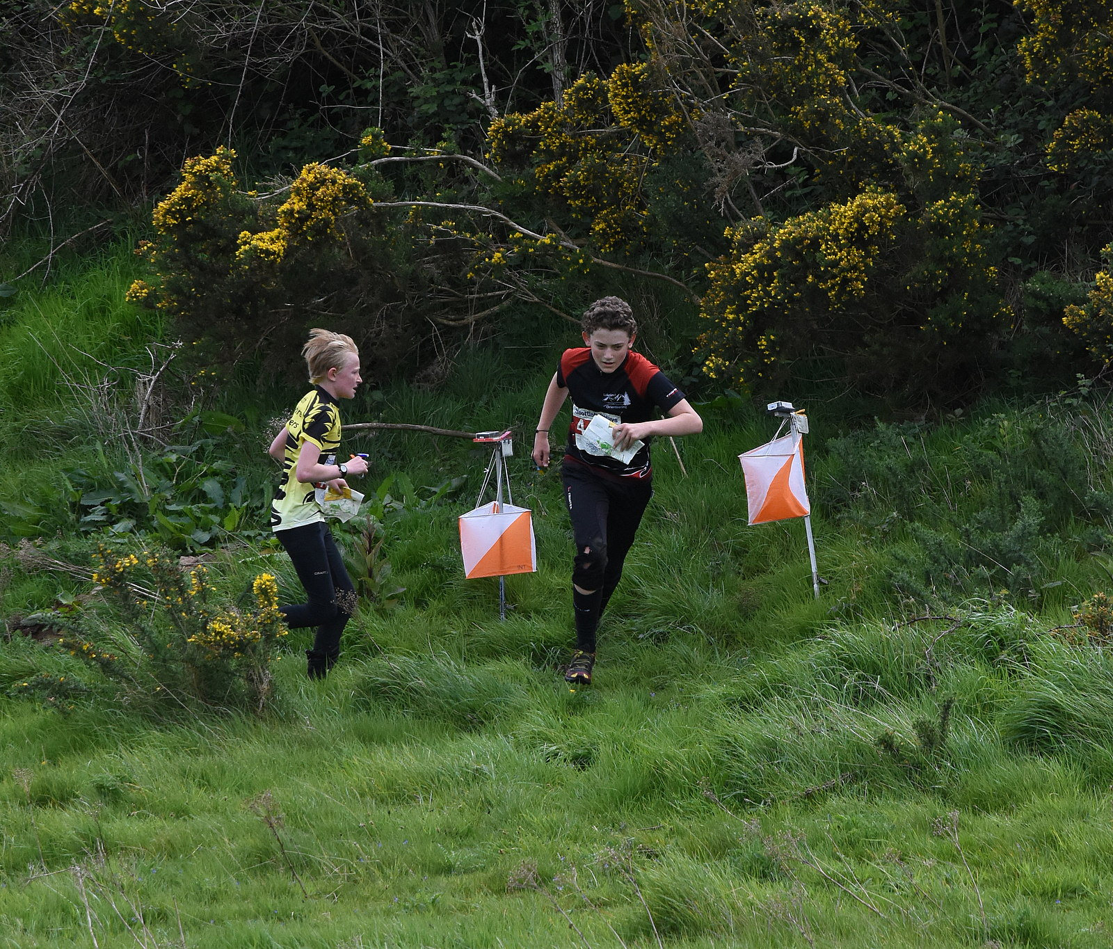 2 young orienteers enjoying group activity Scotland