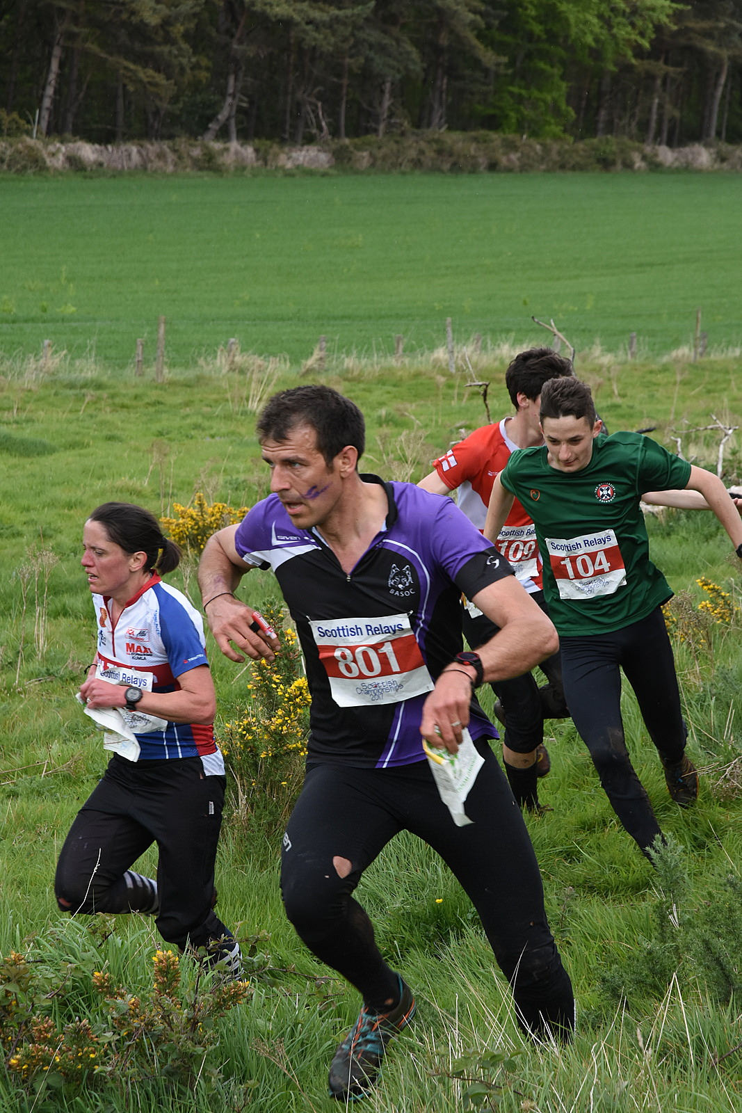 Orienteers racing hard in the Scottish outdoors
