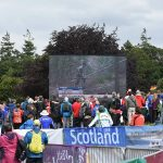 WOC crowd watching orienteering on large screen in the great outdoors