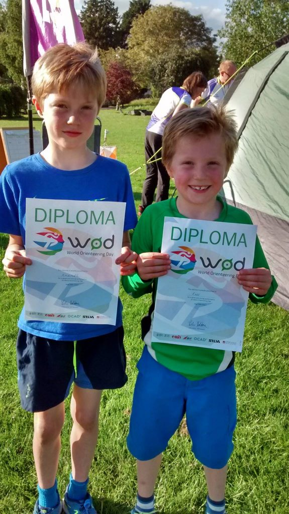 2 young orienteers with diplomas enjoying family activities