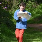 Young person orienteering in the Scottish countryside