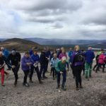 Orienteering mass start as a group activity in the Scottish mountains