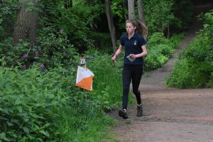 Orienteer approaching control point on an orienteering competition in the great outdoors