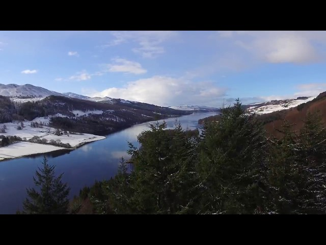 Snowy loch and hill view in the Scottish Highlands